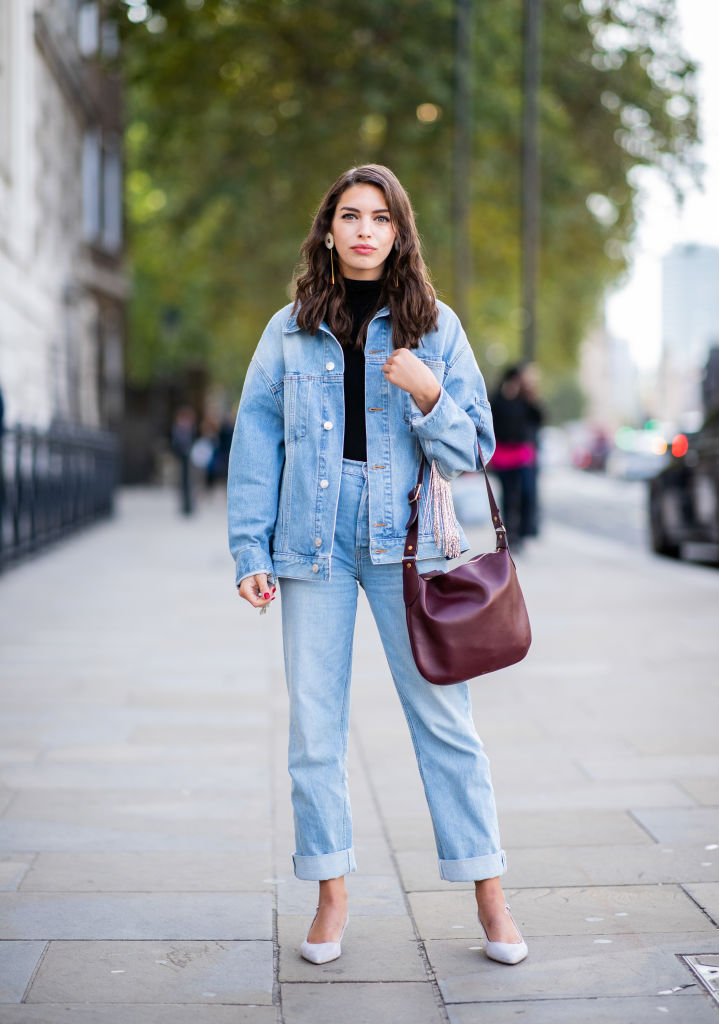 LONDON, ENGLAND - SEPTEMBER 15: A guest wearing denim jeans, denim jacket, earring is seen outside Anya Hindmarch during London Fashion Week September 2018 on September 15, 2018 in London, England. (Photo by Christian Vierig/Getty Images)