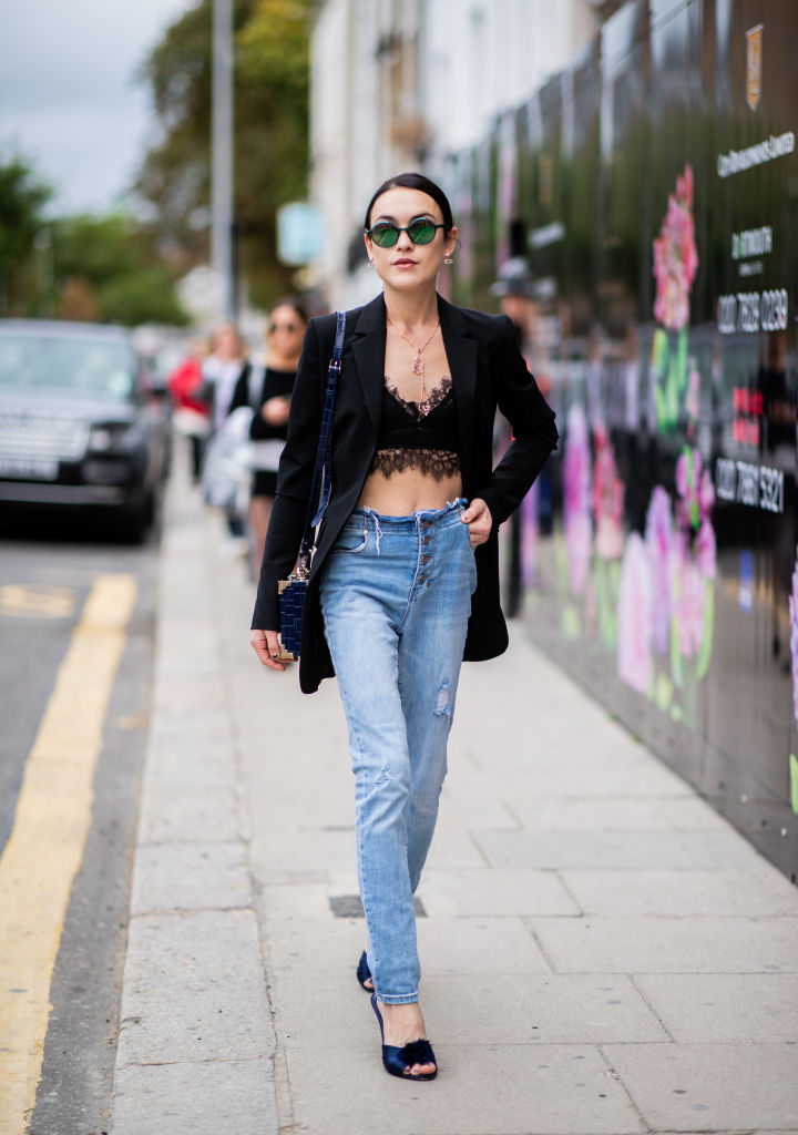 LONDON, ENGLAND - SEPTEMBER 18: A guest wearing denim jeans, cropped top, black jacket is seen outside Natasha Zinko during London Fashion Week September 2018 on September 18, 2018 in London, England. (Photo by Christian Vierig/Getty Images)